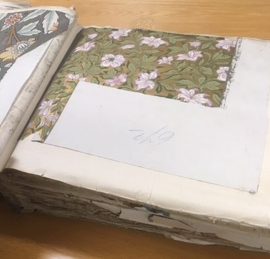 The image shows Inside a representations book (catalogue reference BT 43/102) - a large book open at a page showing a wall paper sample folded into the book..