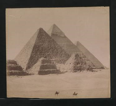 The pyramids at Giza in Egypt, 1890s, with two tiny images of camels in the foreground (catalogue reference CO 1069/179).