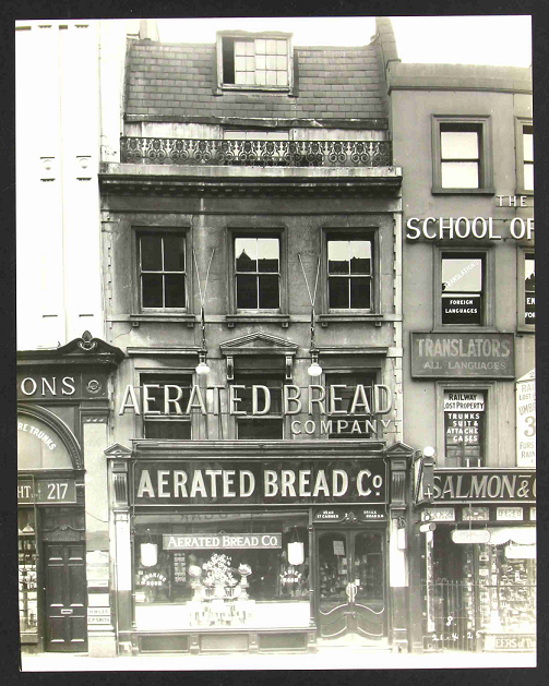 A four-storey, terraced building occupied by the 'Aerated Bread Company' at No. 216 Piccadilly, London, 1925 (catalogue reference CRES 43/151/8).