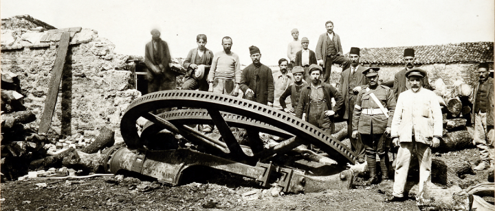A picture of a group of men (a cropped version of the original), some in military uniform, others in civilian clothing, gathered around a destroyed 28cm gun, is among an album of 170 photographs taken during the Gallipoli Campaign (catalogue reference WO 317/1/30).