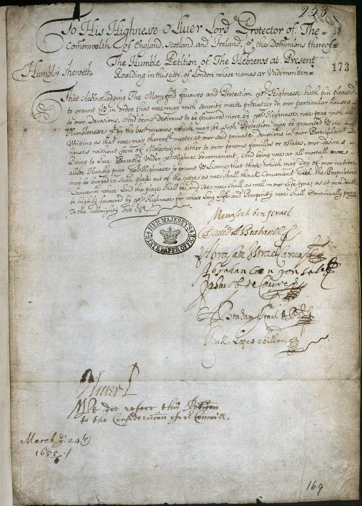 An image of a hand-written petition on parchment, signed by around half a dozen signatories.